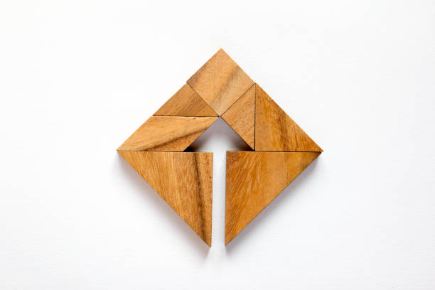 Tangram puzzle as arrow in square shape on white background (Concept for business direction and decision) stock photo