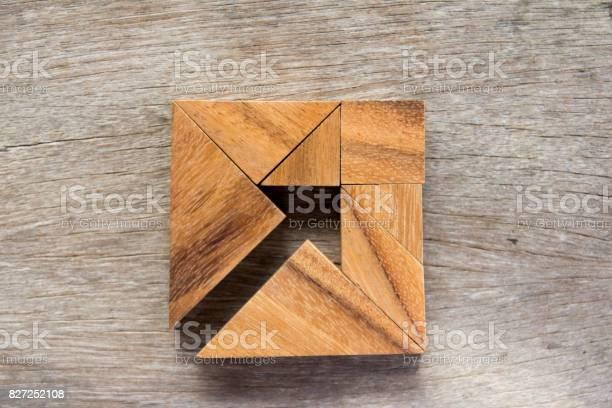 Tangram puzzle as arrow in square shape on wooden background picture id827252108?b=1&k=6&m=827252108&s=612x612&h=n pllic3eablgzhvdb6 fw9ug m8c4jbwulyvqqm6gq=