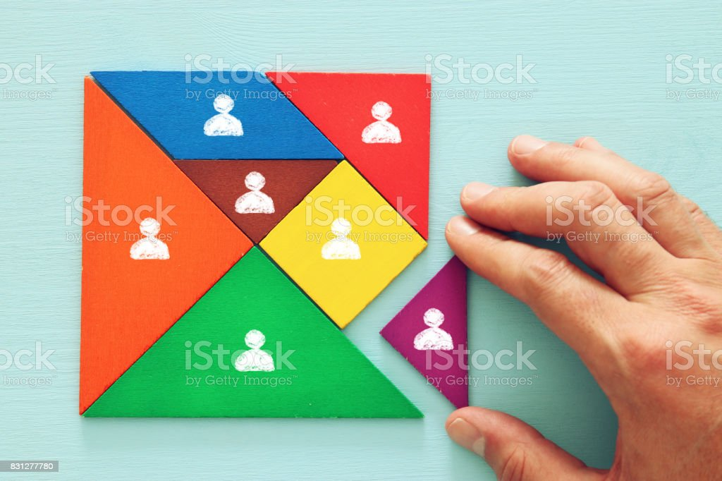 tangram puzzle blocks with people icons ,human resources and management concept. foto stock royalty-free