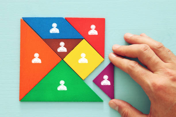 tangram puzzle blocks with people icons ,human resources and management concept. image of tangram puzzle blocks with people icons over wooden table ,human resources and management concept. military recruit stock pictures, royalty-free photos & images