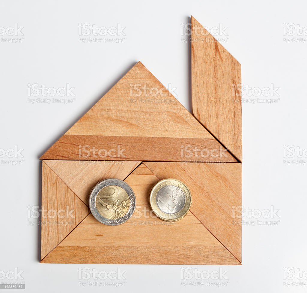 Tangram Puzzle Figure: House and Euro coins stock photo