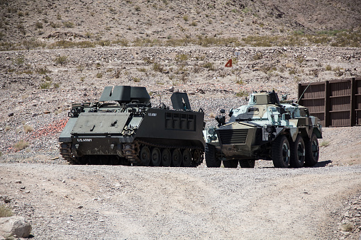 The olive green armoured tank is for bringing troops into the combat zone. The smaller, six wheeled vehicle could be used engaging smaller numbers of ground troops or riots and in scouting missions.