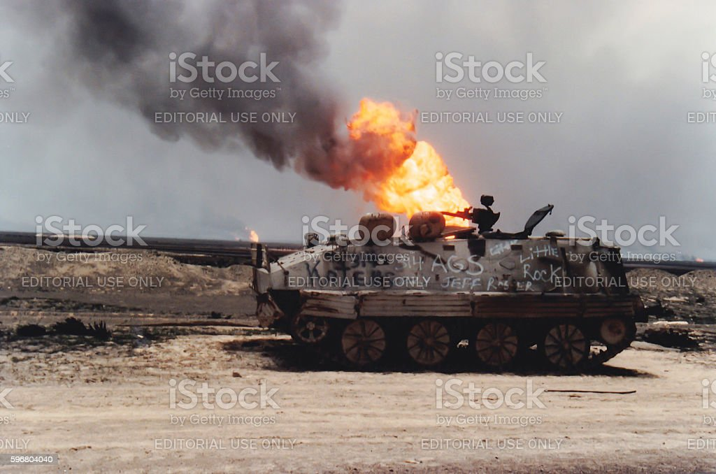 Tank and oil well fire, Kuwait, Persian Gulf War stock photo