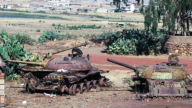 tank and other war vehicles cemetery in the asmara eritrea, - horn of africa stock photos and pictures