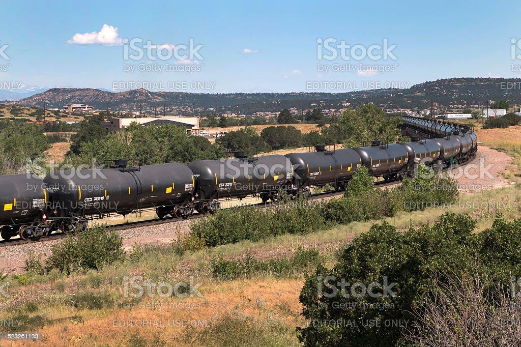 Tank car train rolls through Castle Rock Colorado stock photo