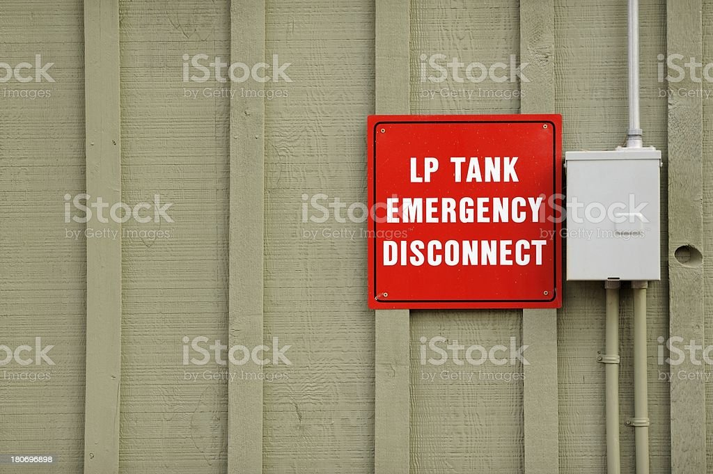 Sign on wall LP propane tank emergency disconnect with switch panel.