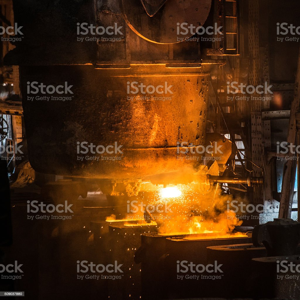 Tank pours the liquid steel in the forms stock photo