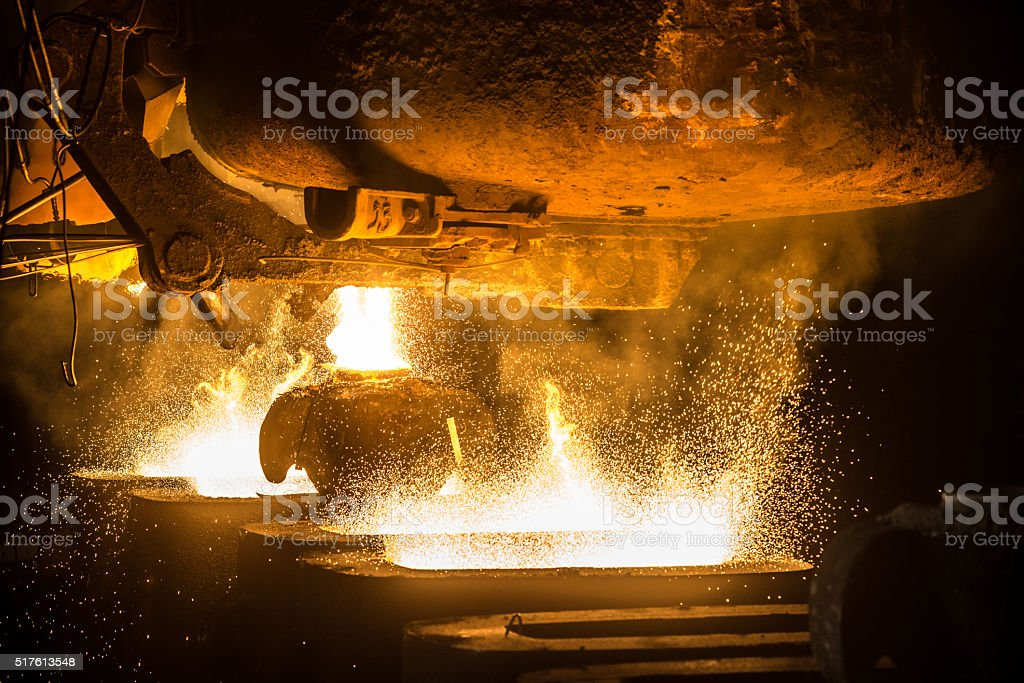 Tank pours the liquid steel in the molds stock photo