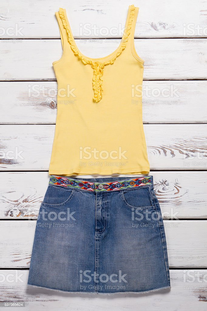 Tank top and jeans skirt. stock photo
