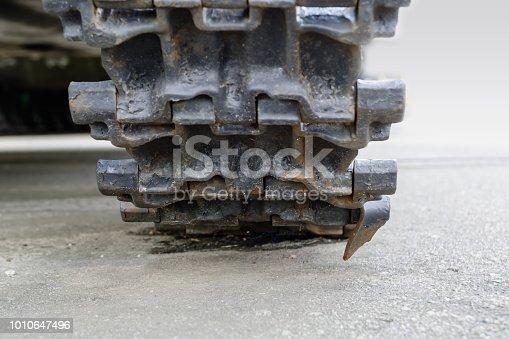 istock Tank tracks. Caterpillar armored closeup shot. Black track link. Chassis tank. 1010647496