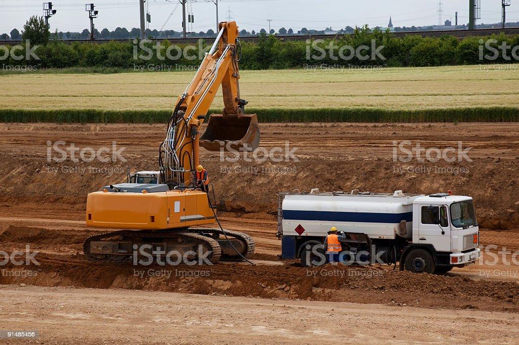 Tank truck filling bulldozer royalty-free stock photo