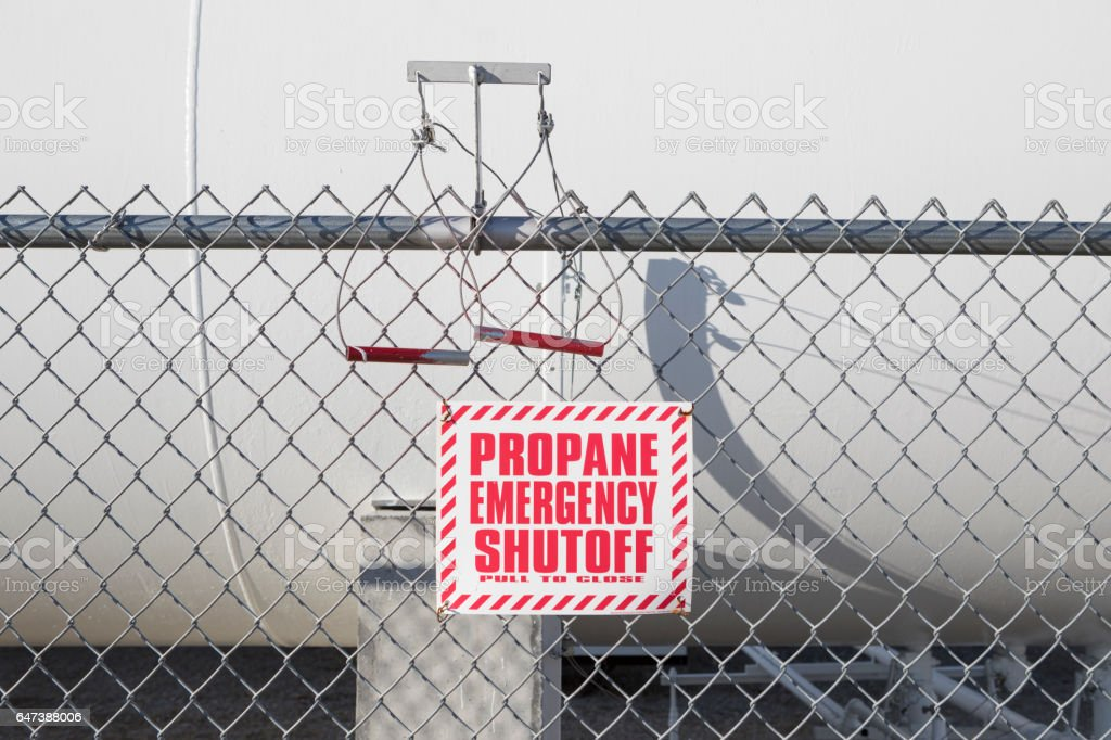 Large LP or LPG storage tank and a emergency warning sign on the...