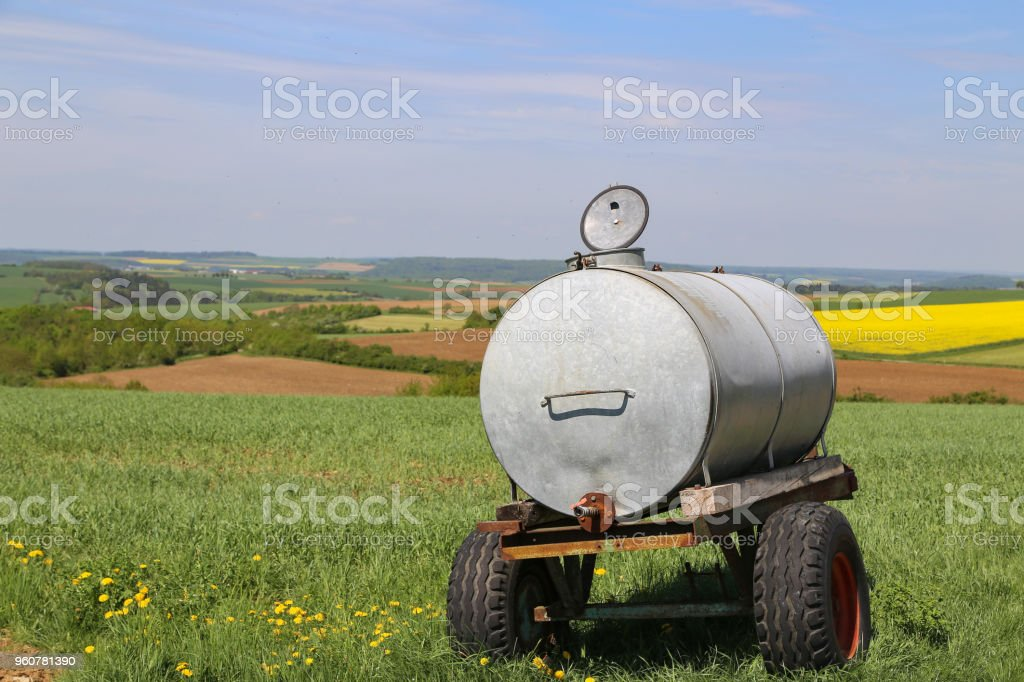 Tank with water in the field stock photo