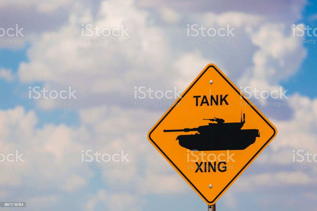 Tank xing crossing sign with humvee on the road stock photo