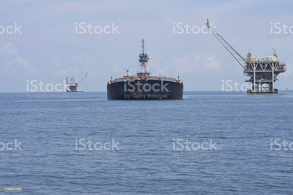 Tanker and oil platforms royalty-free stock photo