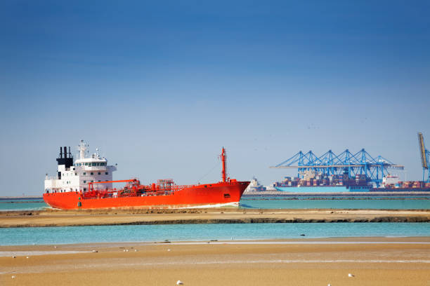 Tanker at the commercial loading dock of Le Havre Huge cargo tank ship at the commercial loading dock of Le Havre le havre stock pictures, royalty-free photos & images