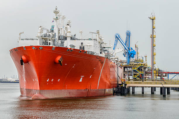 LNG tanker in port Liquefied natural gas tanker ship in port. mooring stock pictures, royalty-free photos & images