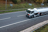 White Tanker lorry in motion on the road