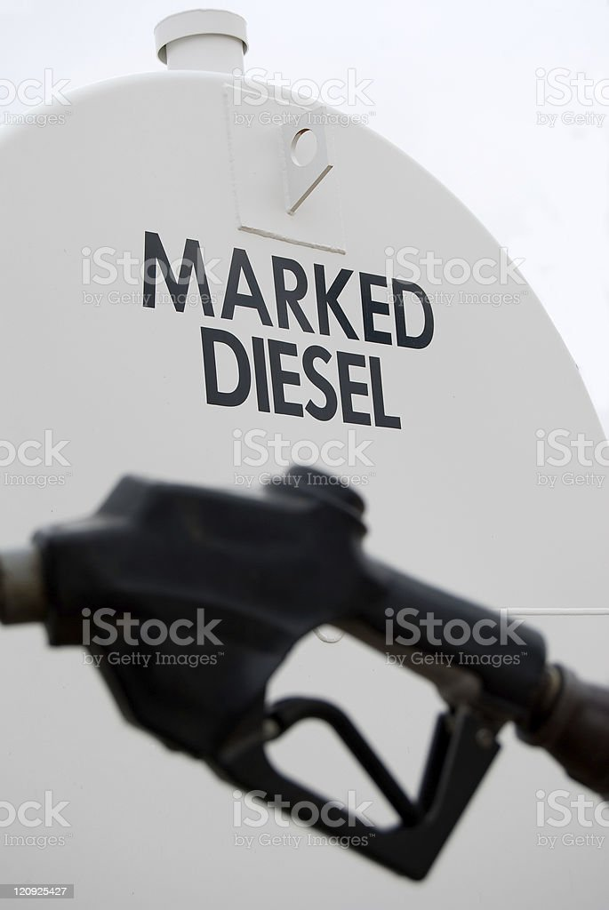 Tanker of marked diesel and part of a petrol pump. royalty-free stock photo