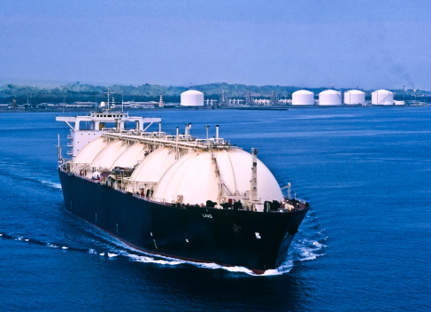LNG Tanker leaving Asian liquefaction plant to deliver natural gas to consumers.