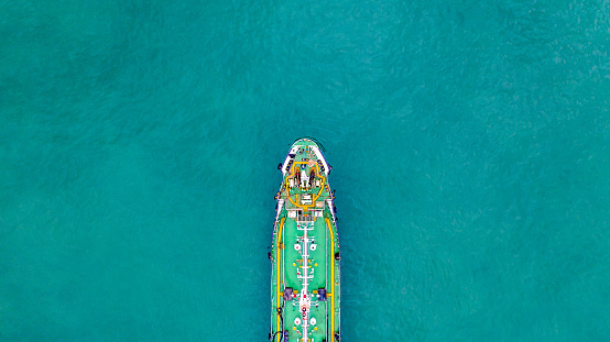 Tanker ship carrying oil and gas in the sea support freight transportation import export business logistic, Aerial view tanker ship.
