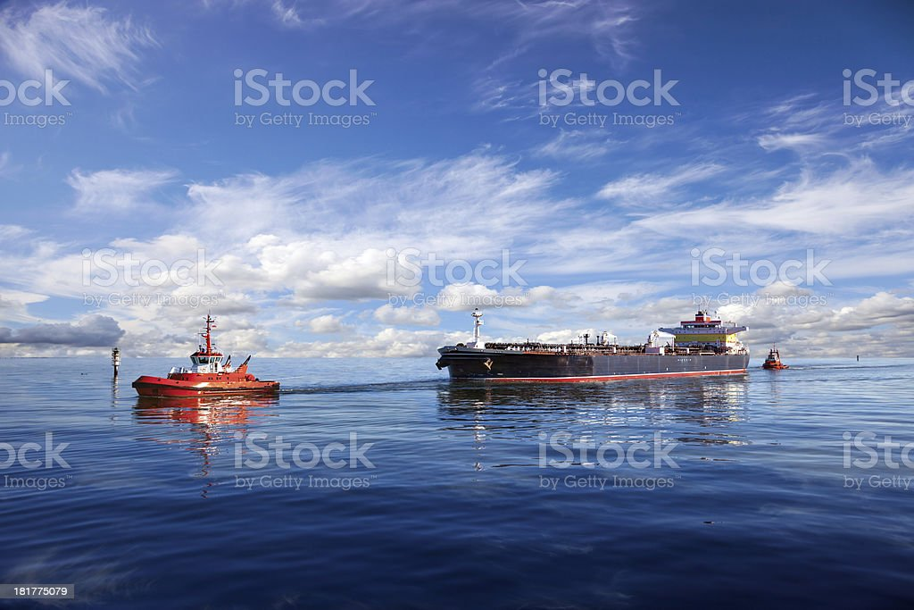 Tanker ship in the water with another boat stock photo