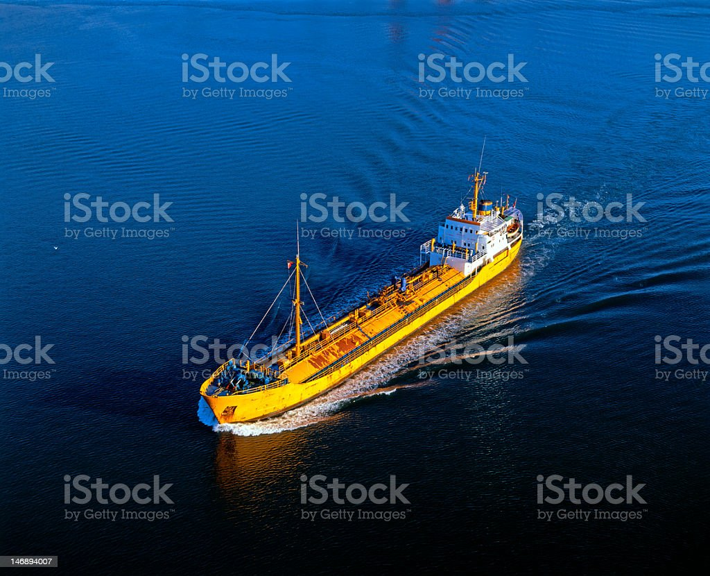 Tanker ship sailing in dark lake royalty-free stock photo