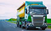Truck with liquid or oil storage in road or highway of Poland. Lorry with service tanker cistern at logistics work. Semi trailer tank. Cargo car drive. Freight delivery. Transport export industry