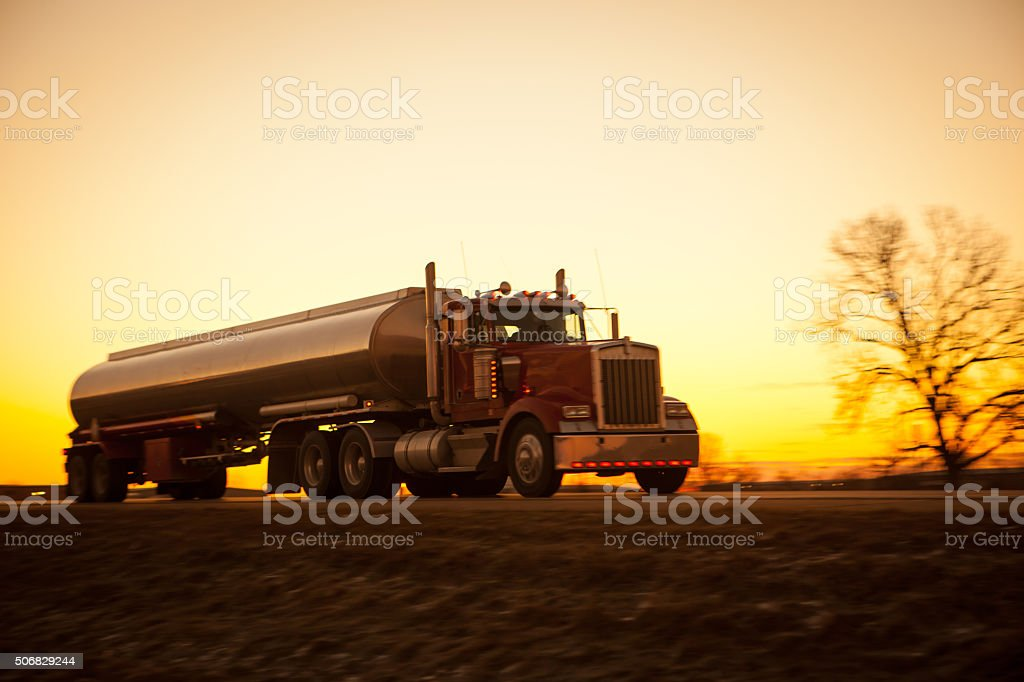 Tanker truck at dawn on the highway. stock photo