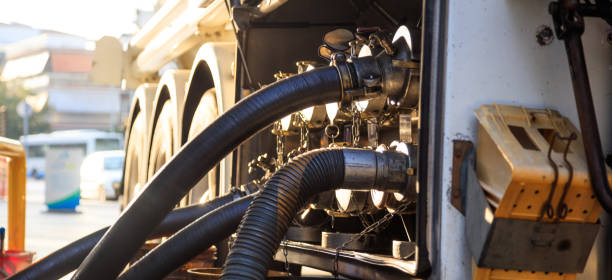 Tanker truck at the service station. Tanker truck filling up storage tank at the fuel station hose stock pictures, royalty-free photos & images
