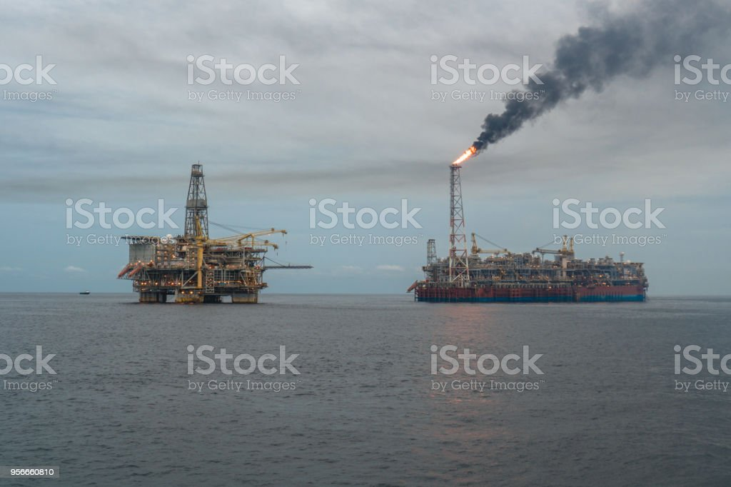 FPSO tanker vessel near Oil Rig platform. Offshore oil and gas...
