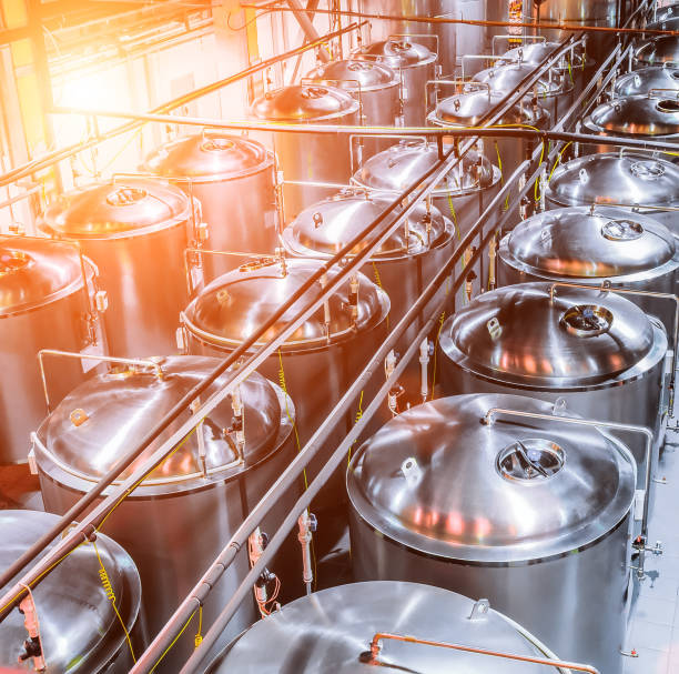 Tanks of stainless steel for the fermentation beer stock photo