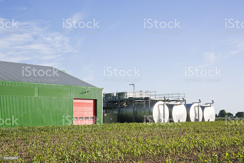Tanks outside warehouse in rural landscape stock photo