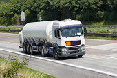 Tank/silo truck on the highway. Hazardous freight (liquid air). All identifiable logos and number plates have been removed carefully.