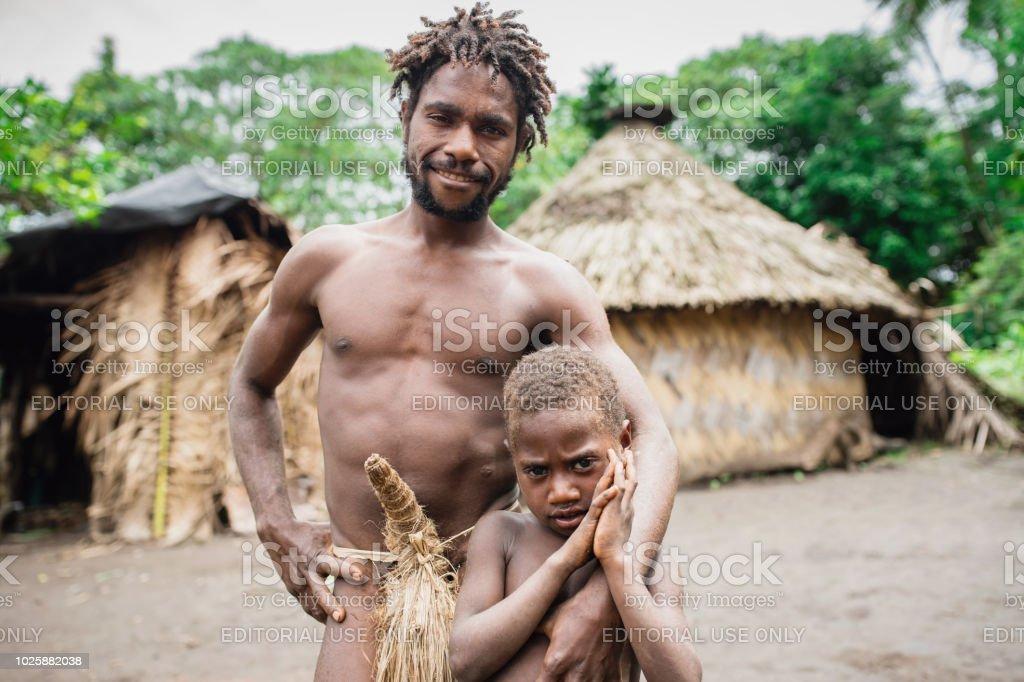 Tanna Island Tribal Chief and Son Kastom Village Vanuatu stock photo