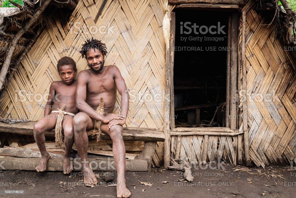 Tanna Island Tribe Young Father  and Son Kastom Village Vanuatu stock photo