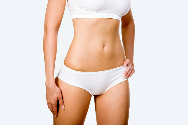 tanned woman's body - human abdomen stock pictures, royalty-free photos & images