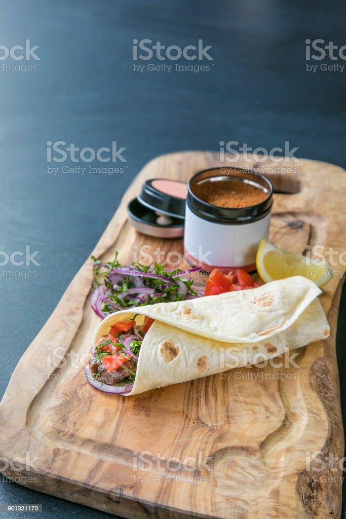 Tantuni kebap dürüm with veggies and spices stock photo