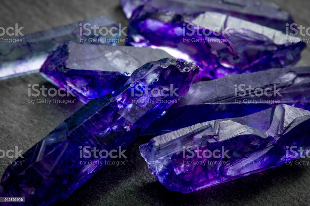Tanzanites and raw crystal gems concept stock photo