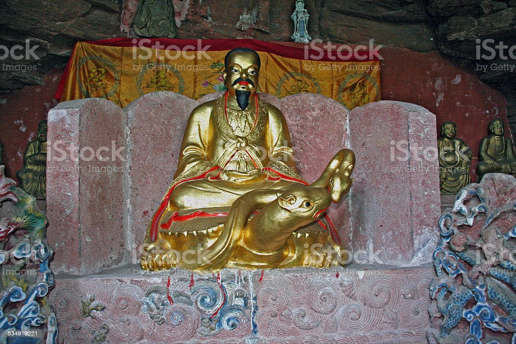 Taoist statues carved in rock , Anhui Province, China, oil paint stock photo