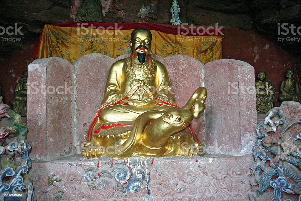 Taoist statues decorating altar carved in rock at Qiyun Mount stock photo