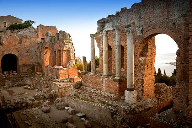 Taormina, Greek theater at sunset Greek theatre. Taormina, Sicily, Italy sicily stock pictures, royalty-free photos & images