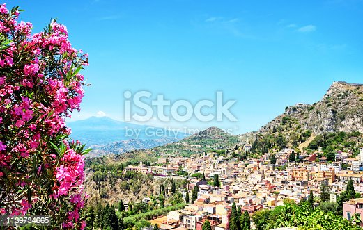 Taormina town with Mount Etna on background