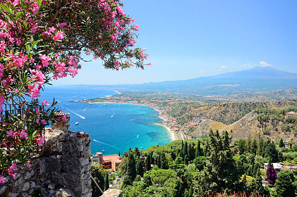 Taormina, Sicily Taormina town with Mount Etna on background sicily stock pictures, royalty-free photos & images