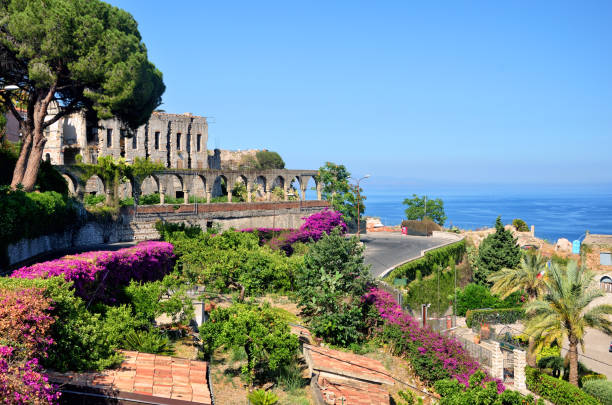 Taormina, Sicily Taormina town with Mediterranean Sea on background sicily stock pictures, royalty-free photos & images