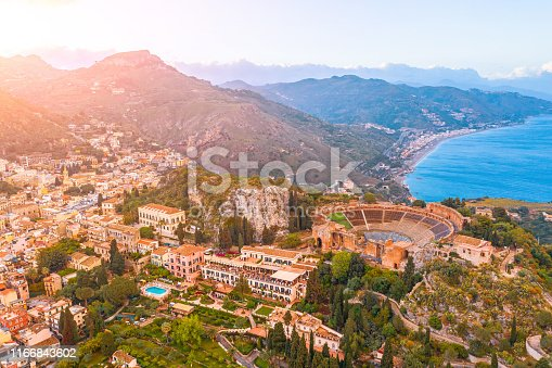 Taormina theater, amphitheater, arena is a town on the island of Sicily, Italy. Aerial view from above in the evening sunset
