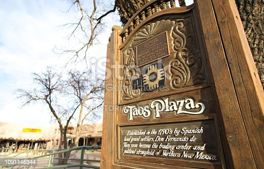 Taos, NM: A memorial plaque in the historic Taos Plaza in early morning winter light.