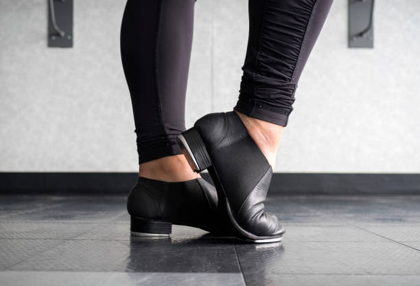 Tap dancer at the barre in dig stock photo