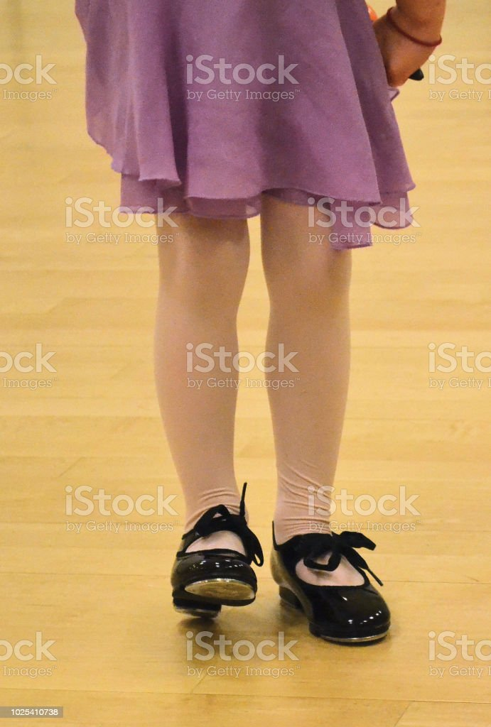 5 year old girl in tap shoes facing camera, legs only Naperville,...
