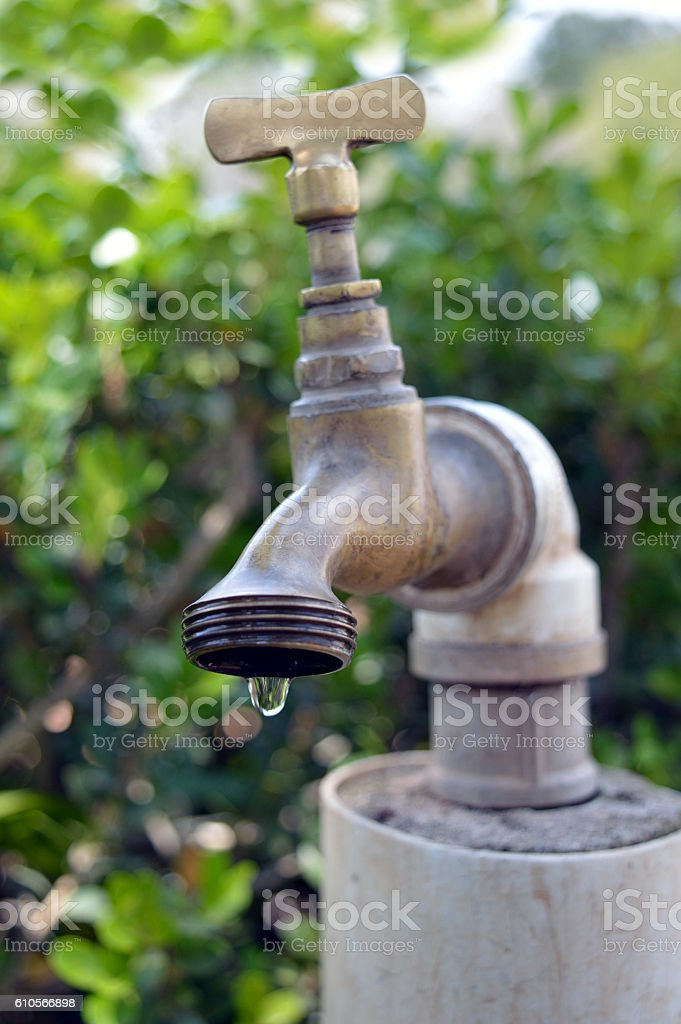 Tap of Water Leaking with a green background